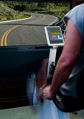image of exercise bike  - stationary bike with road on the big screen - JPG
