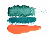 Orange Lip Gloss, Turquoise Eyeshadow And Eye Pencil Smears On White Background. Makeup Colorful Pal poster