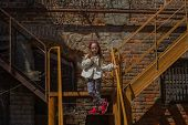 Tracking Shot Of Little Girl In Linen Dress Lying On Railing Of Staircase And Sliding Down.little Gi poster