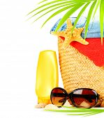 Conceptual summer fun border, beach items isolated on white background, summertime tropical vacation and travel, women's accessories for outdoor relaxation, holidays