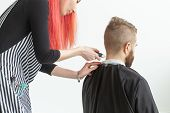 Hairdresser, Hairstylist And Barber Shop Concept - Woman Hairstylist Cutting A Bearded Man poster