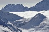 Clouds And Fog Above, Beautiful Winter Landscape In The Alps