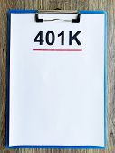 Paper With 401k Plan On Wood Table poster