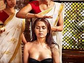 pic of panchakarma  - Young woman having head ayurveda spa treatment - JPG