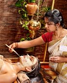 foto of ayurveda  - Woman having facial mask at ayurveda spa - JPG