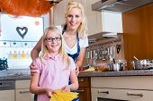 image of lasagna  - Mother and daughter cooking together - JPG