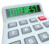 A plastic calculator displays the word Interest as you figure how the percentage interest rate you will pay on borrowed money or the money you will make on investments