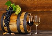stock photo of spigot  - Still life with glasses of red and white wine barrel with grapes - JPG