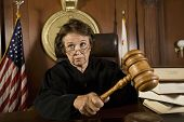 pic of courtroom  - Senior Caucasian judge holding mallet in courtroom - JPG
