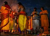 KUALA LUMPUR - JANUARY 27: A Hindu priest prays and blesses a family at dawn in preparation for thei