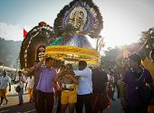 KUALA LUMPUR - JANUARY 27: Hindu devotees carry 'kavadi' as offering to Lord Muruga with beliefs to