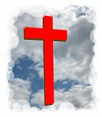 Red colored cross against clouds