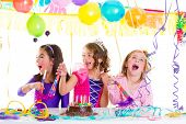 stock photo of fancy cake  - children kid in birthday party dancing happy laughing with balloons serpentine and garlands - JPG