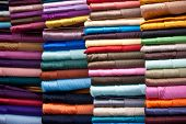 stock photo of handicrafts  - stacked colorful fabrics in the Grand Bazaar in Istanbul Turkey - JPG