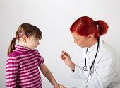 The Pediatrician Inoculating A Small Girl