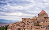 Dome and houses of Volterra in Italy