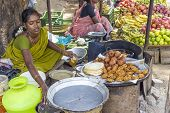 Indian Women Sells Bread And Fresh Boiled Cakes