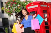 stock photo of phone-booth  - Shopping woman in London walking happy holding shopping bags - JPG