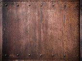 stock photo of ironclad  - old metal background with rivets - JPG