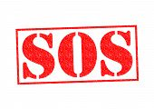 stock photo of sos  - SOS Rubber Stamp over a white background - JPG
