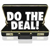Do the Deal words in a black leather briefcase to illustrate closing the sale and successfully final