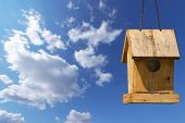 Little Old Birdhouse On Blue Sky