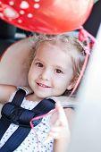 Happy Toddler Girl In Car Seat