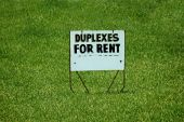 Duplexes Fro Rent Yard Sign On Grass poster