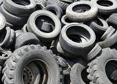 Heap of black old used automobile car tires garbage for recycling