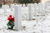 stock photo of arlington cemetery  - Tombstones in winter - JPG