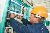 electrician at work checking wire with drawing inspecting high voltage power electric line distribution fuseboard