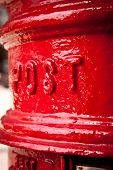 Close-up on red post box