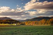 stock photo of virginia  - The sun sets over the appalachian mountains and country farm in Virginia - JPG