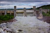 stock photo of hydroelectric  - water start-up through a hydroelectric power station dam in Imatra Finland