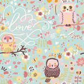 Bright spring seamless pattern in pastel colors. Cute owls on branches in butterflies and flowers in