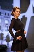ZAGREB, CROATIA - OCTOBER 5: Fashion model in cocktail dress on 'Wedding days' show on October 5, 20