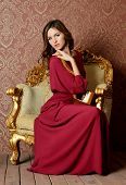 The elegant sensual woman in claret dress