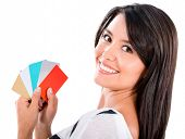 Happy woman with a handful of credit cards - isolated over white