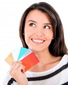 Pensive woman with credit cards thinking how to spend money
