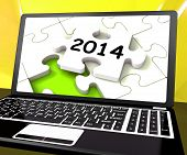 Two Thousand And Fourteen On Laptop Shows New Years Resolution 2014