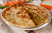 stock photo of pakistani  - A traditional and hot Pakistani and Indian bread with filled mince