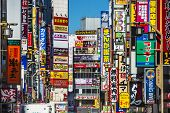 TOKYO, JAPAN - MARCH 15, 2014: Signs densely line an alleyway in Kabuki-cho. The area is a renown ni