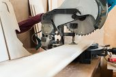 Circular saw and wood plank