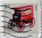 UNITED STATES OF AMERICA - 2002: A stamp printed in USA shows image of a vintage red vehicle