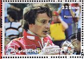 GUINEA - CIRCA 1998: Stamp printed in Guinea shows Gilles Villeneuve
