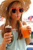 Beautiful Girl In Sunglasses, Ice, Slush On Beach