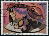 GUYANA - CIRCA 1990: A stamp printed in Guayana shows Still life with guitar by Pablo Picasso