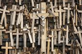 Many wooden votive crucifixes.