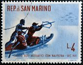 SAN MARINO - CIRCA 1961: A stamp printed in San Marino dedicated to hunting shows waterfowl hunting
