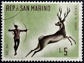 SAN MARINO - CIRCA 1961: A stamp printed in San Marino dedicated to hunting shows Archery deer